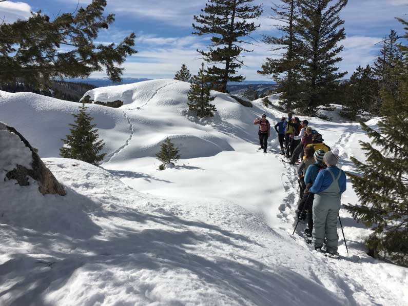 adults show shoeing on a beautiful mountain in steamboat springs colorado